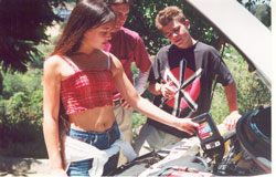 Merit Academy students learn auto shop skills like changing oil in their cars