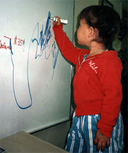 Merit students begin learning how to write in preschool.